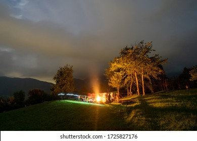 scouts or boys in the evening around the fire, starry sky