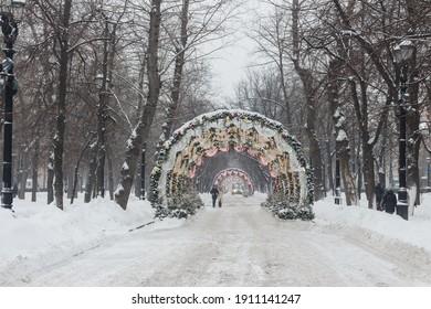 scow, Russia. Jan 22, 2021: Tverskoy Boulevard full of snow. New Year decorations. People walking