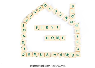 Scrabble Letter Tiles Forming House Shape for First Home Concept, Isolated on White Background.