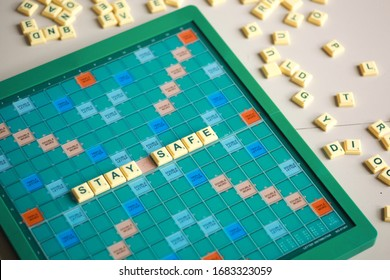 Scrabble letters spelling Stay Safe that relate with Global Coronavirus virus crisis. Bandung Indonesia, March 2020