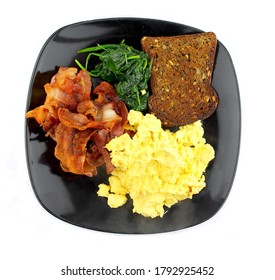 Scramble egg and bacon with a slice of toast white background