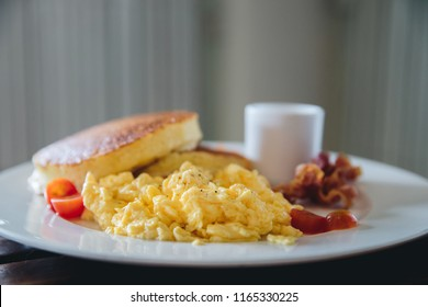 scramble egg with pancake and bacon breakfast food in film vintage style