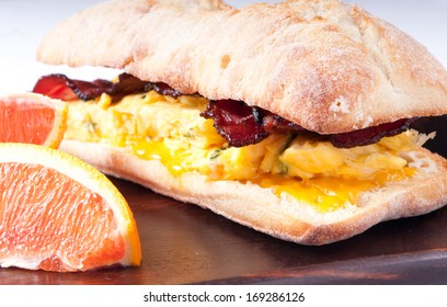 scrambled egg and bacon sandwich with gooey melted cheese