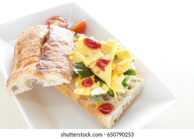 scrambled egg and green onion French bread sandwich