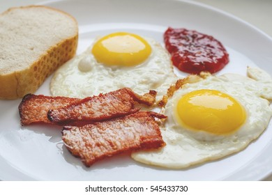 scrambled eggs bacon bread ketchup