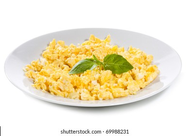 scrambled Eggs with basil on white background