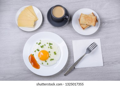 scrambled eggs, espresso with croutons and cheese