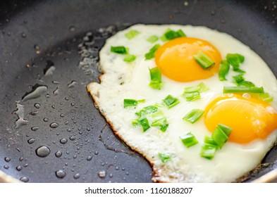 Scrambled eggs in a frying pan