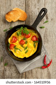 scrambled eggs with grilled tomatoes