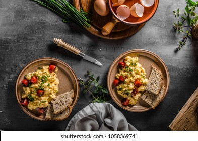 Scrambled eggs with herbs, roasted tomatoes, chive