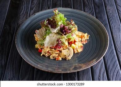 Scrambled eggs with mushrooms and romaine, batavia, lettuce, salad