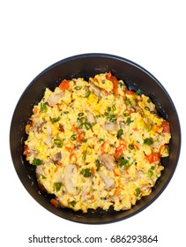 scrambled eggs with mushrooms and vegetables in a frying pan. top view. isolated on white