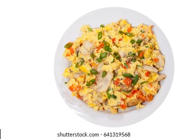 scrambled eggs with mushrooms and vegetables. top view. isolated on white