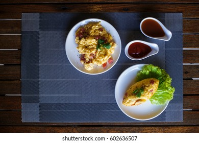 scrambled eggs and omelet on the table.