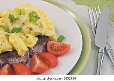 Scrambled eggs on toast with cherry tomatoes on toast