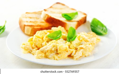 Scrambled eggs and toasts. Selective focus