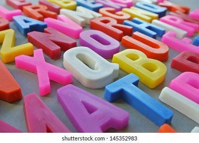 Scrambled letters together in a colorful background