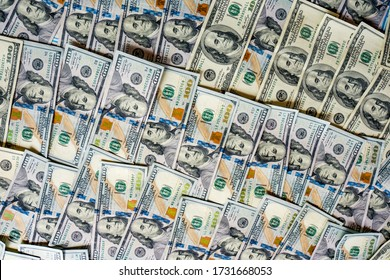 SCRANTON, PA - August 16, 2020: Several 100 US dollar bills stacked together.