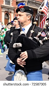 SCRANTON, PA - MARCH 14: A man plays the bagpipes in the Scranton St. Patrick's Day parade on March 14, 2009. Scranton holds one of the largest parades in the United States.
