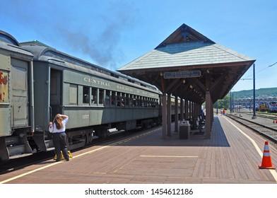 SCRANTON, PA, USA - AUG 7, 2010: Historic Central Railroad of New Jersey Passenger Coach 1157 on platform in Steamtown National Historic Site in Scranton, Pennsylvania, USA.