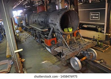 SCRANTON, PA, USA - AUG 7, 2010: Steam locomotive under repair in Steamtown National Historic Site in Scranton, Pennsylvania, USA.