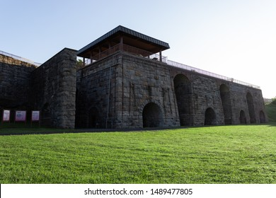 Scranton, PA, USA, August 24, 2019: Illustrative editorial image of The Scranton Iron Furnaces during the early morning sun.