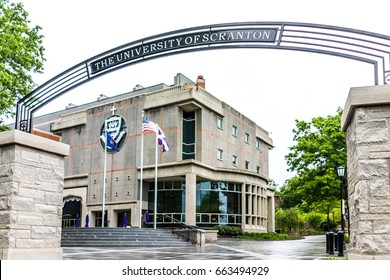 Scranton, USA - May 25, 2017: University of Scranton library building with sign and entrance and flags