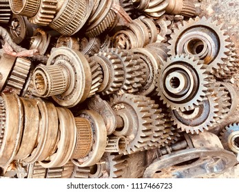 Scrap Car and machinery Parts. Scrap parts in garage wall. Scrap parts removed from used cars and machinery. Parts isolated from the unused car and machinery. Scraps for second used part shop. Gears.