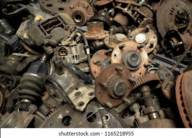 Scrap Car and machinery Parts. Scrap parts in garage wall. Scrap parts removed from used cars and machinery. Parts isolated from the unused car and machinery. Scraps for second used part shop.