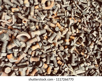 Scrap Car and machinery Parts. Scrap parts wall background. Scrap parts removed from used cars and machinery. Parts isolated from the unused car and machinery. Scraps for second used part shop.