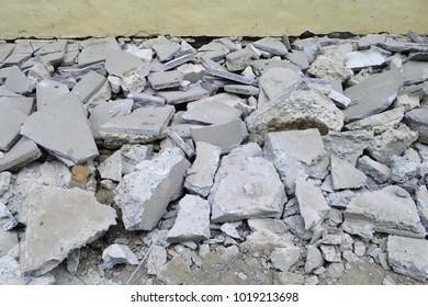 Scrap concrete,  rubbish stones, Heap of concrete and brick rubble debris in construction area. Soft focus. Industrial concept.