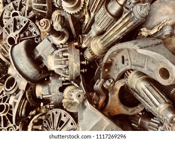 Scrap engine Car and machinery Parts. Scrap parts foctory wall. Scrap parts removed from used cars and machinery. Parts isolated from the unused car and machinery. Scraps for second used part shop.