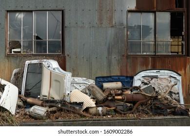 Scrap metal from car parts at junk garage