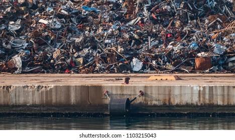 scrap metal pile junk waste environmental destruction