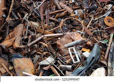Scrap metal in railway cars.. Scrap yard, metal rubbish stock.
