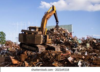 Scrap metal recycling plant and crane-Loading scrap in a truck