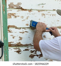 Scraping Old Paint off of Wooden House