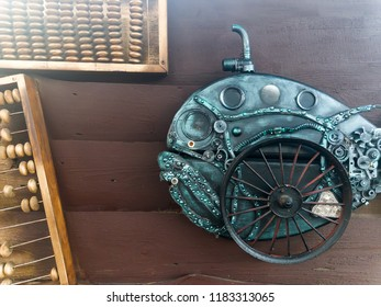 scrap-metal fish made from recycle metal on old wooden wall