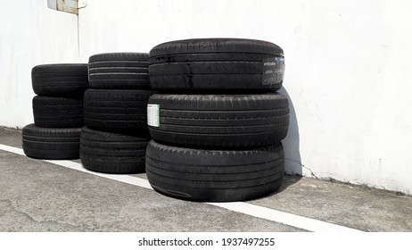 Scrapped tires are used as decoration in a car maintenance center in Taoyuan city, Taiwan. Scrapped tires are rubber and may cause environmental problems. 2021-3
