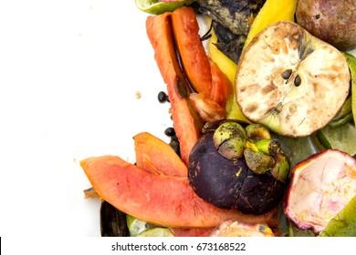 Scraps waste leftover peel fruit crumbs and rotten of apple, papaya, banana, mangosteen, mango, passion fruit, lemon on empty space isolated on white background.