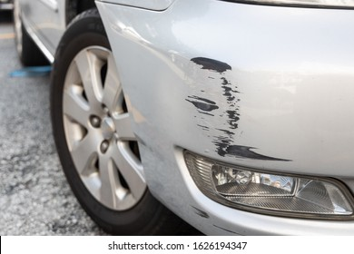 Scratch abrasion on car front bumper due to minor accident