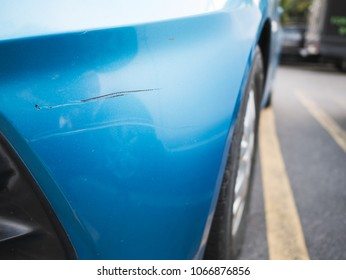 Scratch on the blue car