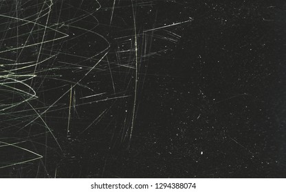 Scratched film texture. Many bright lines in different directions on a dark background. Perfect for grunge design.