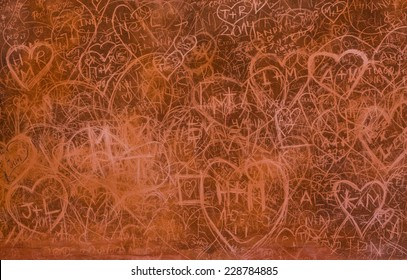 Scratched hearts on the grunge wall