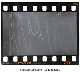 scratched real 35mm film material type 135, photo or movie strip on white background isolated