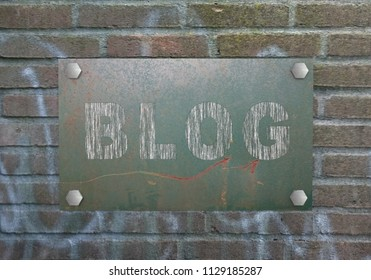 scratched sign with the text Blog hangs on a stone wall. 3d rendering
