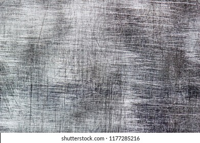 Scratches on the metal background.