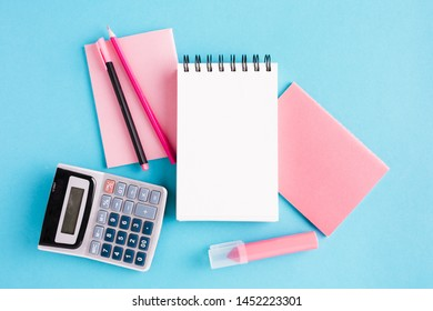 Scratchpad and office tools on blue surface