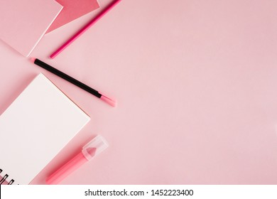 Scratchpad and stationery on colored background
