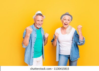 Scream shout rest relax weekend conquer team unity concept. Photo portrait of cheerful amazed crazy modern beautiful funky cool old parents guy rejoicing showing fists isolated on bright background